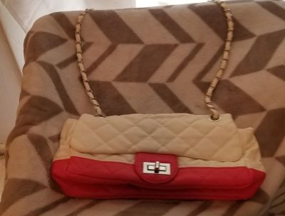 Pink and white clutch purse