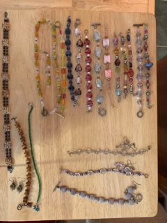 Bundle of earrings, bracelets, and watches