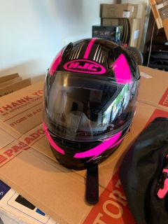 Motorcycle helmet and gloves for a young girl