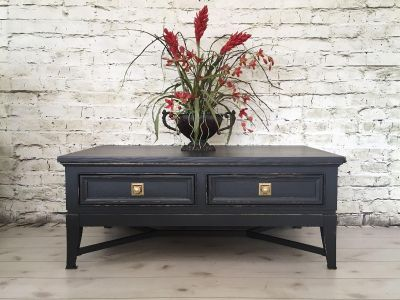 Gorgeous large hand painted coffee table. Custom mix charcoal, distressed and pale gold highlights. Measures 50 wide 21 tall 30 deep.