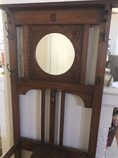 Antique coat hanger, white mirror and decorative wood carving