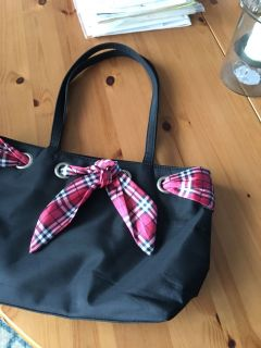Cute black purse with ribbon