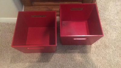Red wooden storage boxes