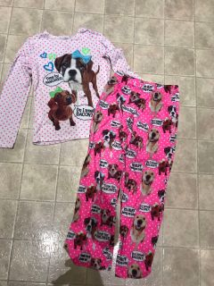Justice puppy pjs says size 14 fits as 12. Has piling but still cute