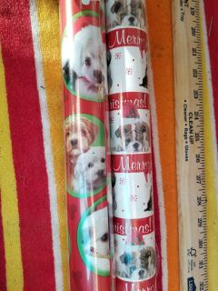 2 rills puppy themed christmas paper. White roll still sealed. Red one top third partially used