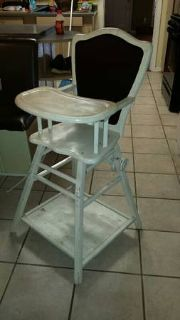 Antique baby highchair turns into a stroller