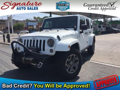 2015 Jeep Wrangler Unlimited 4WD 4dr Rubicon Hard Rock (Bright White Clearcoat)