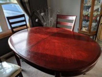 dining table with four chairs and leaf