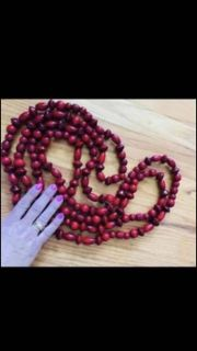 $4 A PIECE Beautiful wooden beads 3 sets 1 price. Burgundy wine color. I think they are 90 some inches