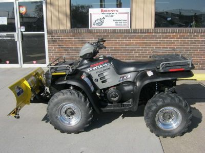 4 wheeler with a snow plow