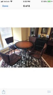 Pier one bar table and 4 chairs