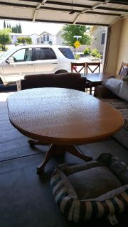 Solid Oak Dining Room table with six chairs - two are captain