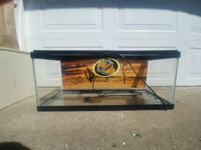 GUC 20 gallon critter tank with locking lid. There is also a heat pad attached to bottom.