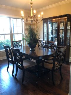 Dining room table and hutch with plant arrangement