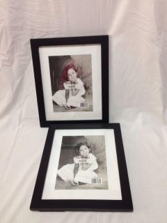 Set of two 8 x 10 Black Wood Frames. One has stand broken off. Both will hang.