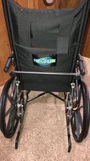 Healthline trading wheelchair with padded armrests