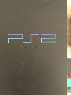 PlayStation 2 with a lot of games, memory card and controller.