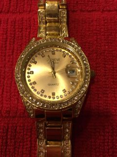 Women's Geneva gold tone watch with crystal accents on dial and band