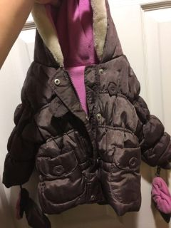 Girls winter coat! Fleece lined, fur hood. Not sure the size but cute and clean