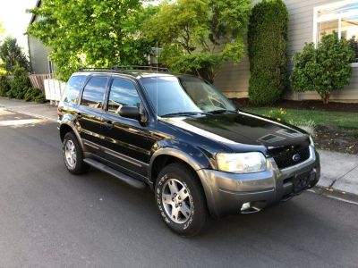 2004 Ford Escape LIMITED 4wd . Low miles 112k