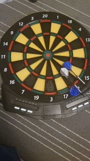 Electric dart board with darts
