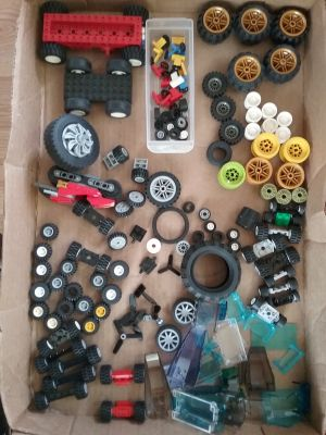Lego lot, Wheels, propellers, steering wheels, chassis, clear plastic windows.