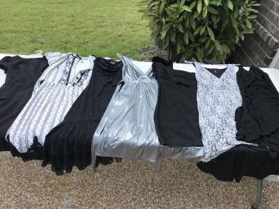 Black, white, silver dress combo. All but one is knee length or shorter