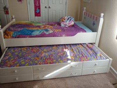 Girls twin bed with trundle includes nightstand and dresser with hutch
