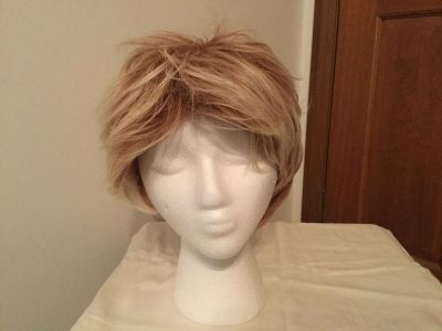 Wig brand new with tag. Natural hair. Adjustable band. Stand not included.