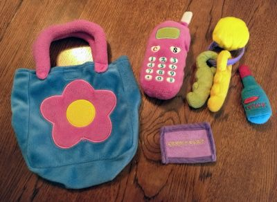 Little girl's plush purse with accessories