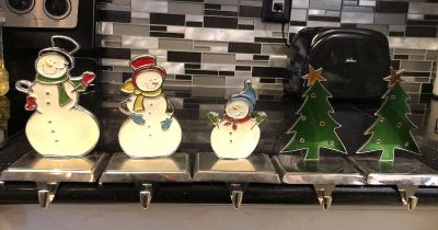 Set of 5 weighted stocking holders $12