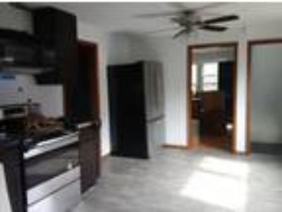 Roommate wanted to share Four BR 1.5 BA House...