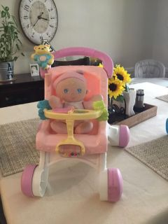 Fisher price doll stroller and doll