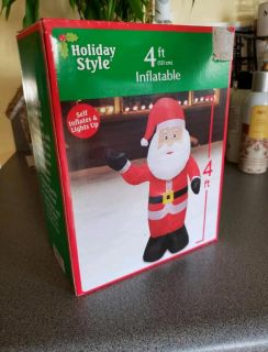 4 ft tall. Self Inflatable Santa. Lights up. Indoor/outdoor use.