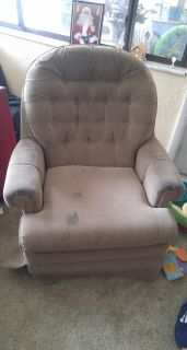 Free chair swivels and rocks. Never tried to get stains out may come out easy.