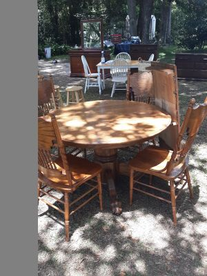 Solid oak pedestal table with claw foot and 5 pressback chairs