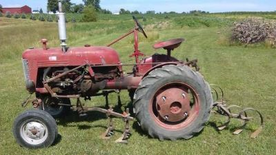 Farmall Cub tractor with implements, weights and extra turf tires