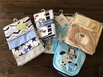 New with tags. $20 for everything. Burp cloths, bibs, bath towel, receiving blankets.