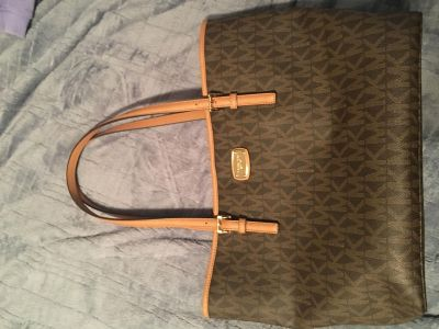 Authentic new Michael Kors purse with tags (never used)