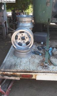 set of 4 used aluminum wheels and spare tire wheel