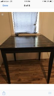 Square kitchen table with two chairs