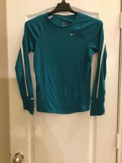 Nike Ladies Dri fit teal long sleeve top. Non smoking home size small.