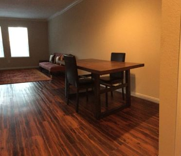 Priced to sell. Moving. New wooden Dining Table with 4 leather chairs