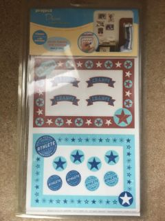 New in package peel and stick photo frame and corners decor
