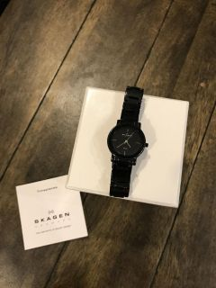 Skagen black metallic ceramic women s watch. Beautiful and excellent new condition! Needs battery (price reflects)