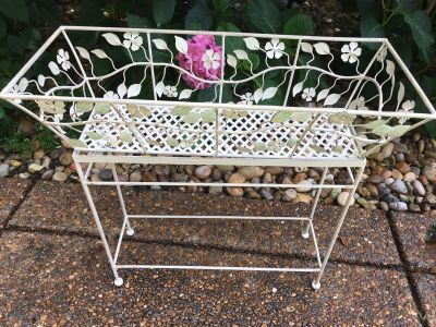 Cream metal plant stand with plants with plants