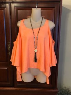 5.00size large Gianni Bini designer neon orange cold shoulder top. The fabric has some color variations at the bottom (not noticeable on
