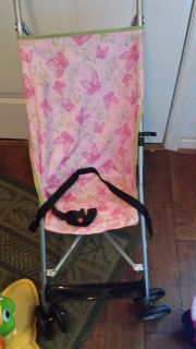 Pink foldable stroller and high chair