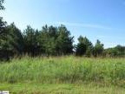 Nice wooded lot in neighborhood offering a po...