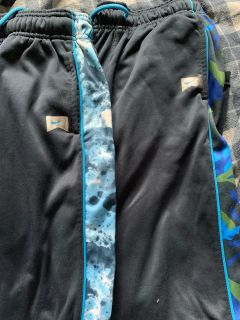 Boys Nike pants, navy blue with side leg design.